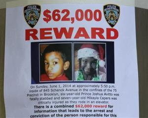 A reward poster is affixed at an entrance to the Boulevard Houses in Brooklyn.