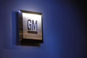 In this Jan. 12, 2009 file photo, the General Motors logo is on display at the North American International Auto Show in Detroit.
