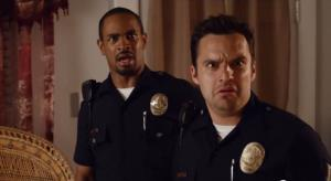 Damon Wayans Jr. and Jake Johnson are seen in a screenshot from the trailer for the upcoming movie Let's Be Cops.