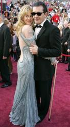 This 2005 file photo shows actor Antonio Banderas with his wife Melanie Griffith, left, at the 77th Academy Awards in Los Angeles.