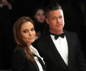 Angelina Jolie and Brad PItt. He's in a tux now, but he used to wear a chicken suit.