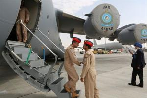 UAE pilots greet each other at the steps of a Boeing C-17 Globemaster III.