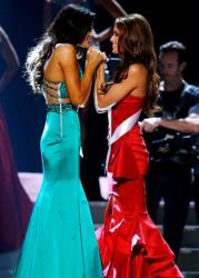 Miss North Dakota USA Audra Mari, left, and Miss Nevada USA Nia Sanchez await the final decision during the Miss USA pageant in Baton Rouge, La.