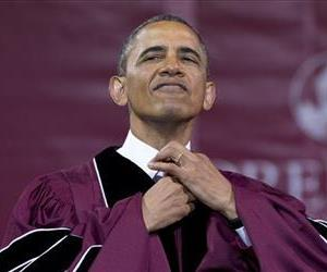 President Barack Obama straightens his tie before he receives an honorary doctorate of laws degree during the Morehouse College 129th Commencement ceremony, May 19, 2013, in Atlanta.