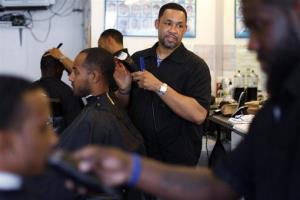 Dorsey Jackson cuts hair at his establishment Jackson's Barbershop, Friday, May 11, 2012, in Ardmore, Pa.