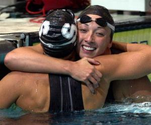 In this Aug. 16, 2000 photo, Amy Van Dyken, right, hugs Dara Torres after Torres won the finals of the women's 50-meter freestyle at the US Olympic Swimming Trials in Indianapolis.