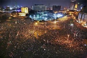 In this Sunday, June 8, 2014 photo, supporters of Egyptian President Abdel-Fattah el-Sissi celebrate his inauguration in Tahrir Square, Cairo, Egypt.