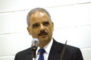US Attorney General Eric Holder delivers his keynote address at a tribal conference on the campus of United Tribes Technical College in Bismarck, ND, on Thursday, June 5, 2014.