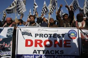 Supporters of Pakistani religious group Jamaat-ud-Dawa rally to condemn US drone attacks in Pakistani tribal areas, Friday, Nov.  29, 2013 in Peshawar, Pakistan.