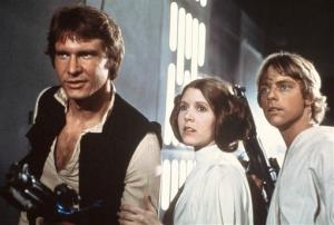 In this 1977 image provided by 20th Century Fox, Harrison Ford, Carrie Fisher, and Mark Hamill are shown in a scene from 'Star Wars.'