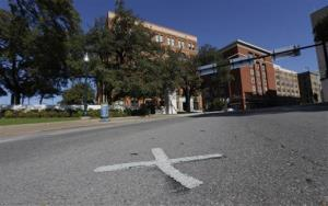 An X marks the spot on Elm Street where the first bullet hit President John F. Kennedy on Nov. 22, 1963 near the former Texas School Book Depository.