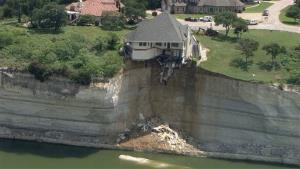 A luxury house teeters on a cliff about 75 feet above Lake Whitney in Whitney, Texas.