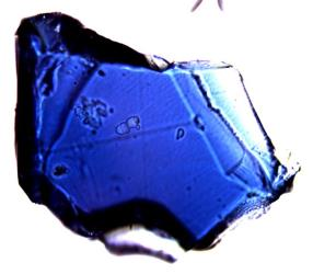 A blue ringwoodite crystal grown in a lab.