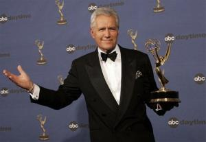 In this Friday, April 28, 2006, file photo, Alex Trebek holds the award for outstanding game show host for his work on Jeopardy!