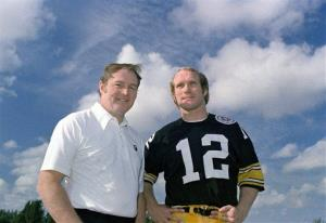 This Dec. 1975, file photo shows Pittsburgh Steelers head coach Chuck Noll, left, and quarterback Terry Bradshaw.