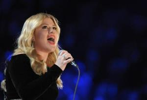 In this Feb. 10, 2013 file photo, Kelly Clarkson performs on stage at the 55th annual Grammy Awards, in Los Angeles.