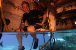 This 2012 photo provided by Mission 31, Fabien Cousteau sits inside Aquarius Reef Base in the Florida Keys National Marine Sanctuary.