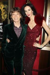 This Nov. 13, 2012 file photo released by Starpix shows Mick Jagger of The Rolling Stones, left, and fashion designer L'Wren Scott at the HBO premiere of his film, Crossfire Hurricane, in New York.