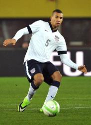 In this Nov. 19, 2013, file photo, US national soccer team player John Brooks dribbles against Austria during a friendly soccer match in Vienna.