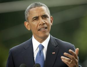 This June 13, 2014 file photo shows President Barack Obama speaking on the South Lawn of the White House in Washington.