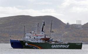 The Greenpeace ship 'Arctic Sunrise'  is escorted by a Russian coast guard boat, in Kola Bay at the military base Severomorsk last fall.