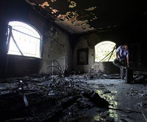 This Sept 13, 2012 file photo shows a Libyan man investigating the inside of the  U.S. Consulate in Benghazi, Libya, after an attack that killed four Americans, including Ambassador Chris Stevens.