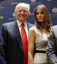 Donald and Melania Trump pose for photos at a news conference, in New York, Thursday, May 1, 2014.