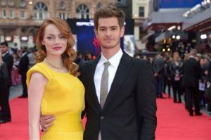 Emma Stone and Andrew Garfield pose for photographers as they arrive on the red carpet for the world premiere of The Amazing Spider-Man 2 in Leicester Square, London, Thursday April 10, 2014.