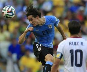 Uruguay's Edinson Cavani heads the ball during the group D World Cup soccer match between Uruguay and Costa Rica at the Arena Castelao in Fortaleza, Brazil, Saturday, June 14, 2014.