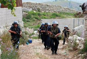 Albanian police enter the lawless village of Lazarat, 140 miles south of Tirana.