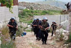 Albanian police enter the lawless village of Lazarat, 140 miles south of Tirana.