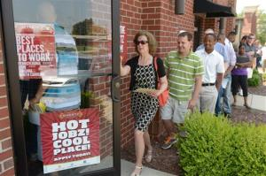 In this Wednesday, June 18, 2014 photo, job seekers attend a job fair in Burlington, N.C.