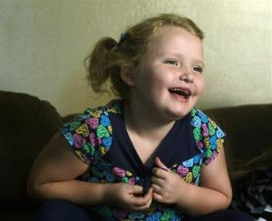 In this Sept. 10, 2012 file photo, beauty pageant regular and reality show star Alana Honey Boo Boo Thompson gestures during an interview in her home in McIntyre, Ga.