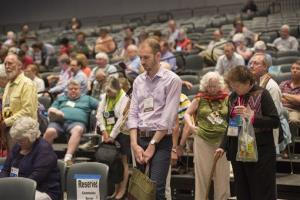 The audience takes part in an opening prayer at the 221st General Assembly of the Presbyterian Church at Cobo Hall, in Detroit on Thursday.