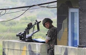 File photo of a South Korean soldier on guard at a military checkpoint near the border village of Panmunjom.