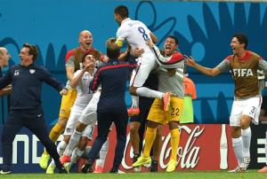 The US' Clint Dempsey celebrates with his teammates after scoring his side's second goal during the group G World Cup soccer match between the USA and Portugal at the Arena da Amazonia in Manaus.