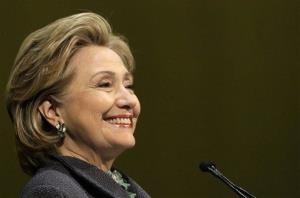 Clinton smiles out to a crowd in Chicago earlier this month during an event to promote her new book.