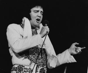 In this May 23, 1977 file photo, Elvis Presley performs in Providence, RI, three months before his death.