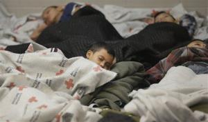This June 18 photo shows children sleeping in a holding cell at a U.S. Customs and Border Protection processing facility in Brownsville,Texas.