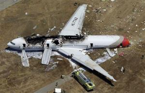 In this July 6, 2013, aerial file photo, the wreckage of Asiana Flight 214 lies on the ground after it crashed at San Francisco International Airport.
