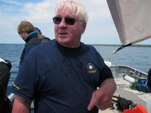 In this 2013 file photo,  Steve Libert speaks on a fishing boat as dive teams prepare to inspect a site in northern Lake Michigan.