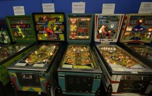 Older pinball machines line a wall of the Seattle Pinball Museum in Seattle.
