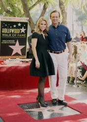 Actress Cheryl Hines, left, and Robert F. Kennedy Jr. attend a ceremony honoring Hines with a star on the Hollywood Walk of Fame on Wednesday, Jan. 29, 2014, in Los Angeles.