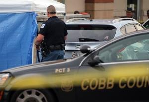Cobb County police investigate an SUV where a toddler died Wednesday, June 18, 2014, near Marietta, Ga.