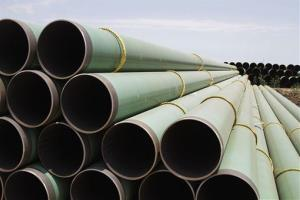 In this May 15, 2011 photo, hundreds of drilling pipes are stacked at a rail center in Gardendale, Texas.