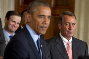 House Speaker John Boehner watches President Barack Obama speak at the White House today.