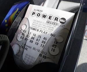 A Powerball lottery ticket is printed out of a lottery machine at a convenience store in this file photo.