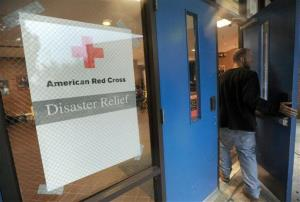 A man enters a Red Cross shelter at Annapolis High School in Annapolis, Md. as Hurricane Sandy approaches the East Coast, Monday, Oct. 29, 2012.