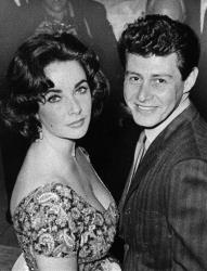 In this 1959 file photo, actress Elizabeth Taylor is seen with singer Eddie Fisher before their marriage.
