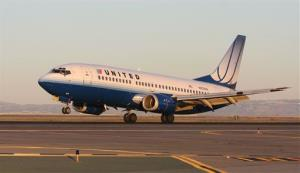 A United Airlines Boeing 737 lands at San Francisco International Airport, Wednesday, Oct. 28, 2009.